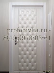 элитная обивка металлической двери каретной стяжкой